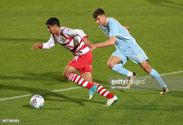 Ethan Robson of Sunderland chases Issam Ben Khemis of Doncaster during the Checkertrade Trophy match between Doncaster Rovers and Sunderland U21 at...