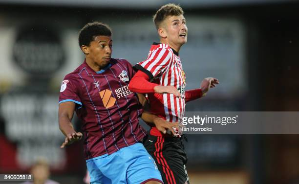 Ethan Robson of Sunderland is injured in a challenge with Devonte Redmond of Scunthorpe during the Checkertrade Trophy group stage match at Glanford...