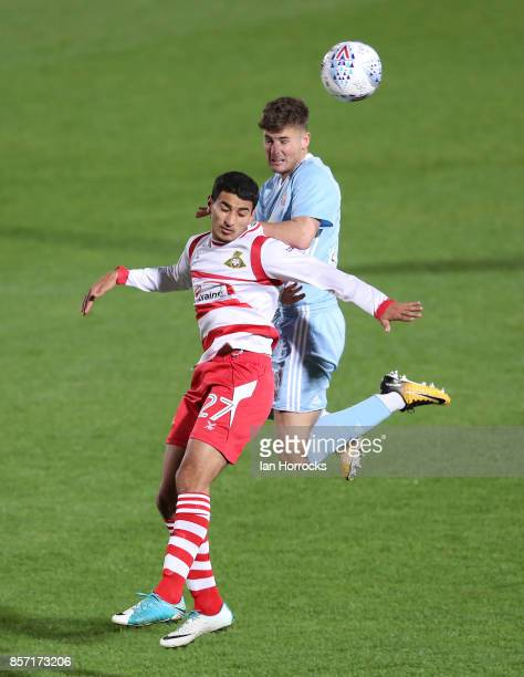 Ethan Robson of Sunderland rises above Issam Ben Khemis of Doncaster during the Checkertrade Trophy match between Doncaster Rovers and Sunderland U21...
