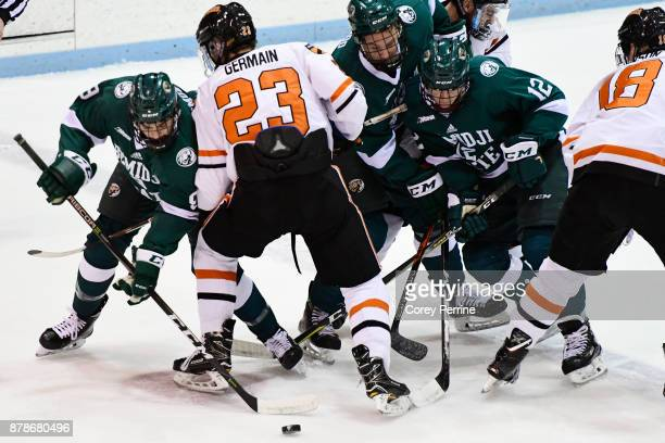 Ethan Somoza of the Bemidji State Beavers faces off against Jeremy Germain of the Princeton Tigers during the first period at Hobey Baker Rink on...
