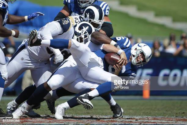 Ethan Westbrooks of the Los Angeles Rams sacks Scott Tolzien of the Indianapolis Colts during the third quarter at Los Angeles Memorial Coliseum on...