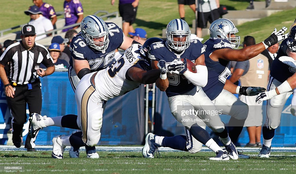 Ethan Westbrooks #93 of the Los Angeles Rams tackles Darius Jackson #34 of the Dallas Cowboys during a preseason game at the Los Angeles Memorial Coliseum on August 13, 2016 in Los Angeles, California.