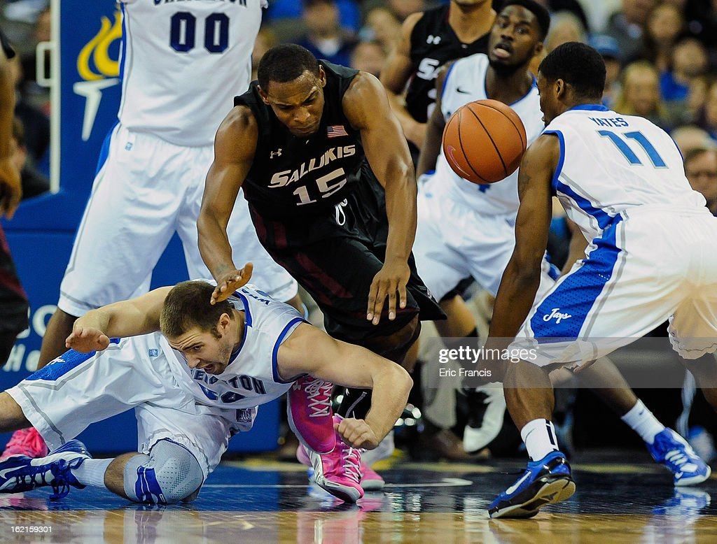 Ethan Wragge #34 of the Creighton Bluejays and Dantiel Daniels #15 of the Southern Illinois Salukis dive for a loose ball during their game at the CenturyLink Center on February 19, 2013 in Omaha, Nebraska.