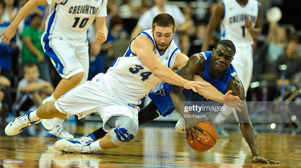 Ethan Wragge #34 of the Creighton Bluejays and Manny Arop #3 of the Indiana State Sycamores fight for a loose ball during their game at the CenturyLink Center on January 5, 2013 in Omaha, Nebraska. Creighton defeated Indiana State 79-66.