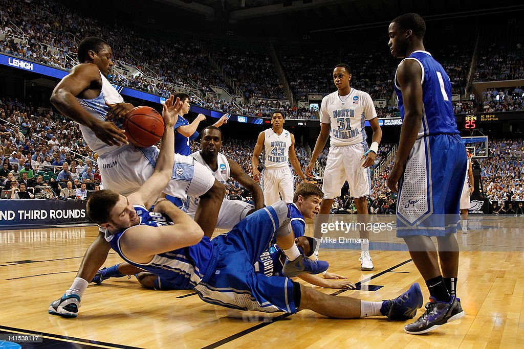 Ethan Wragge of the Creighton Bluejays fights for the loose ball with Harrison Barnes of the North Carolina Tar Heels in the first half during the...