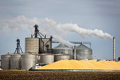A ethanol plant and large pile of corn in the Midwest , U.S.A.