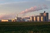 Ethanol Processing Plant in Iowa reflecting sunrise.