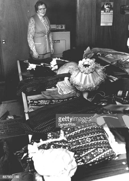 Ethel Lankford who with her husband McClenny distributes clothing and blankets to Indian missions throughout the West overlooks clothes laid out for...