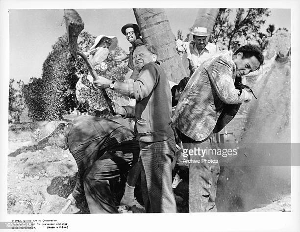 Ethel Merman and Phil Silvers duck as Mickey Rooney shovels through sand in a scene from the film 'It's A Mad Mad Mad Mad World' 1963
