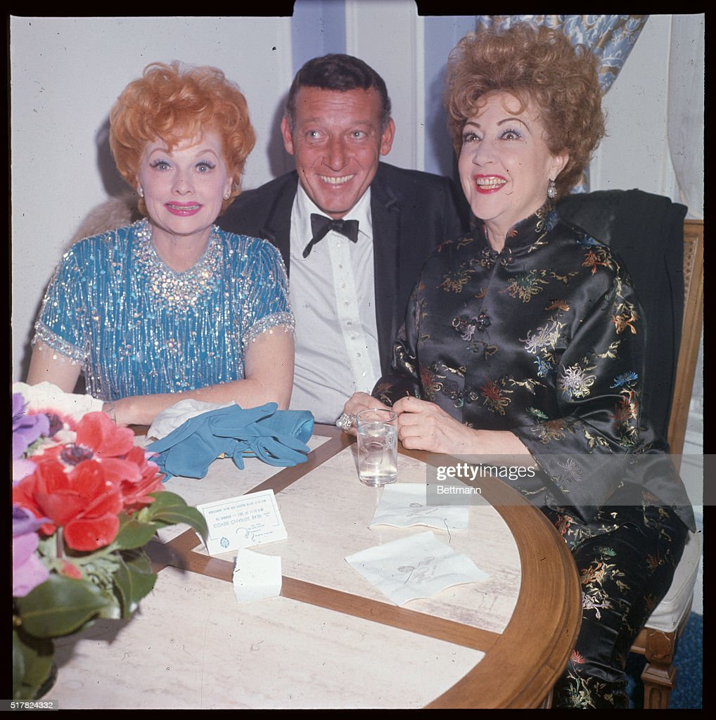 lucille ball and husband gary morton sitting at table with ethel