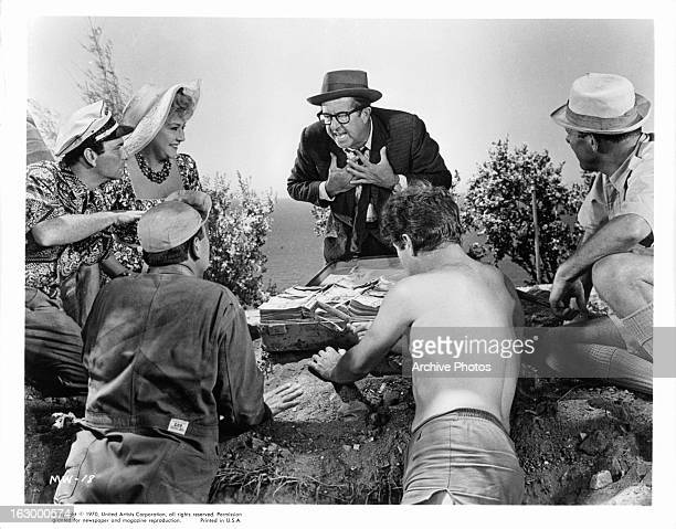 Ethel Merman Phil Silvers and Terry Thomas find the money in a scene from the film 'It's A Mad Mad Mad Mad World' 1963