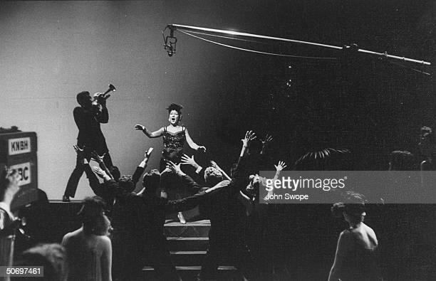 Ethel Merman w trumpeter dancers singing Blow Gabriel Blow w boom microphone overhead cameraman in scene during preliminary rehearsal for Anything...