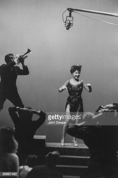 Ethel Merman w trumpeter dancers singing Blow Gabriel Blow w boom microphone overhead in scene during preliminary rehearsal for Anything Goes...