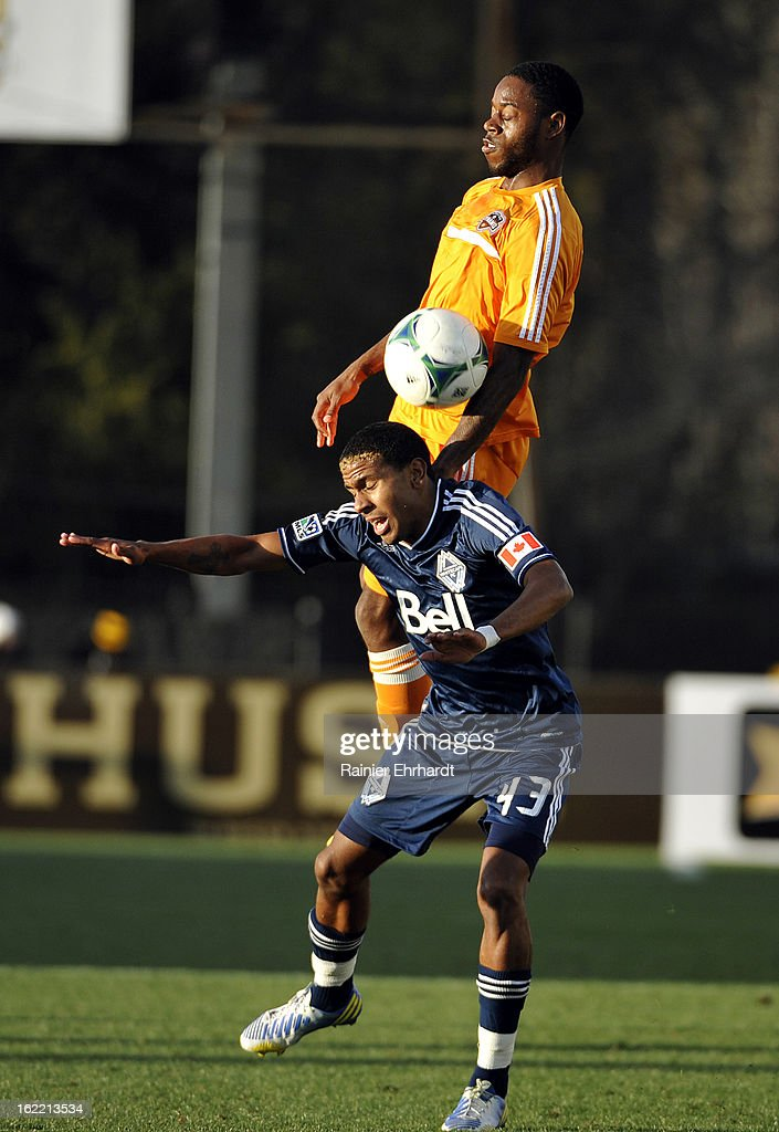 Ethen Sampson #43 of the Vancouver Whitecaps FC and Alex Dixon #19 of the Houston Dynamo battle for the ball during the first half of a game on February 20, 2013 in Charleston, North Carolina.