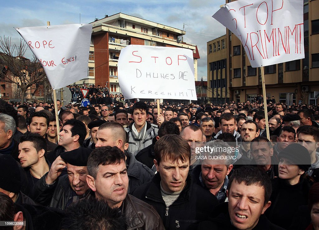 Ethic Albanians protest in Presevo on January 21, 2013, a day after Serbian authorities removed a monument erected in the ethnic Albanian stronghold town of Presevo and dedicated to the fighters in the 2001 conflict against Serbian security forces. The monument, dedicated to the fallen members of the Liberation Army for Presevo, Medvedja and Bujanovac, whose goal was to unite the ethnic Albanian majority area in the Presevo Valley with neighboring Kosovo, was erected in November 2012 in front of the ethnic-Albanian-run municipality building in Presevo. AFP PHOTO / SASA DJORDJEVIC