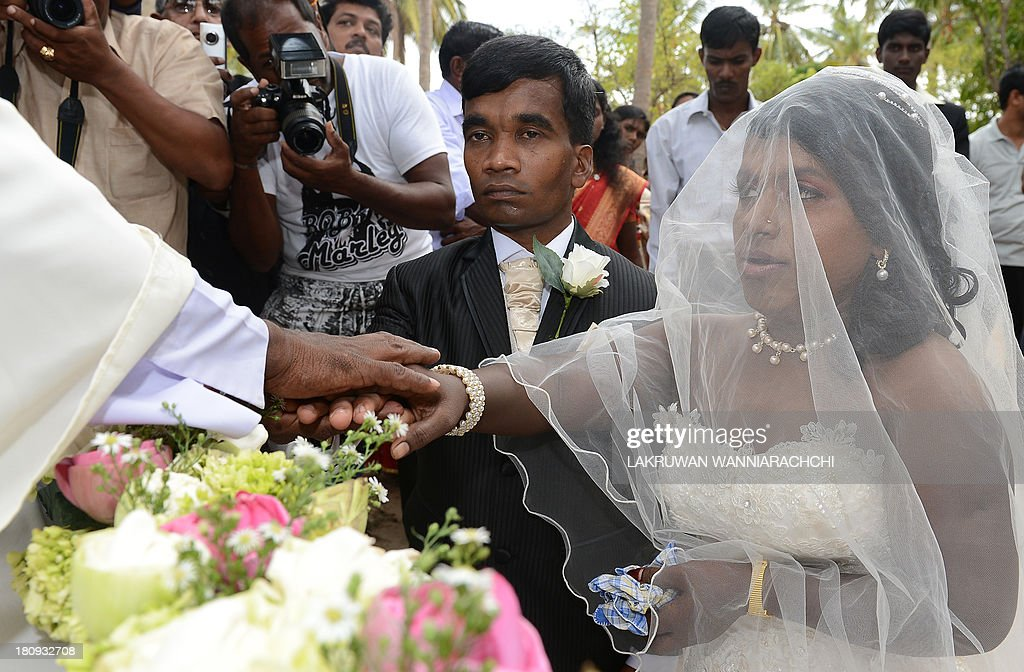 Ethinic Tamil Shashi Kumar a former Tamil Tiger rebel and his ethnic Tamil bride J M Babilaget married in the northern Sri Lanan town of Kilinochchi...
