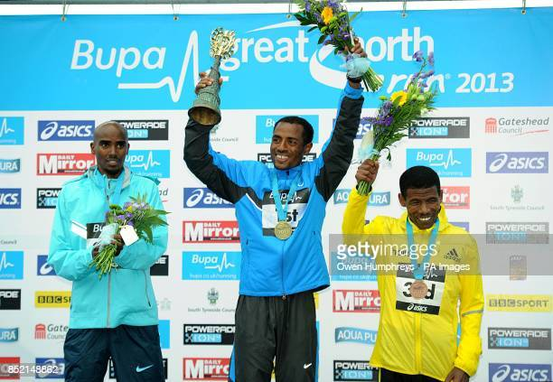 Ethiopa's Kenenisa Bekele celebrates after winning the 2013 Great North Run between Newcastle and South Shields ahead of Great Britain's Mo Farah who...