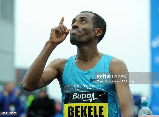Ethiopa's Kenenisa Bekele celebrates winning the 2013 Great North Run between Newcastle and South Shields