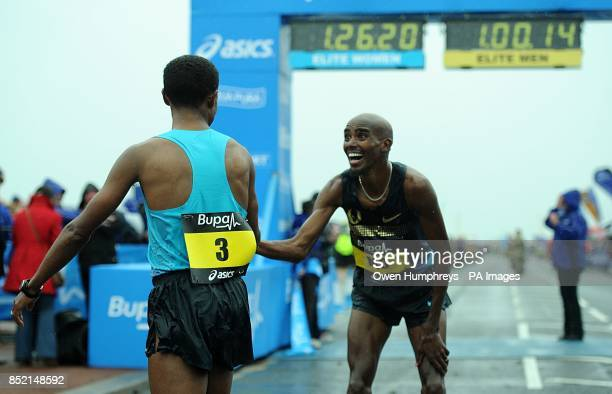 Ethiopa's Kenenisa Bekele is congratulated by after Great Britain's Mo Farah after he won 2013 Great North Run between Newcastle and South Shields...