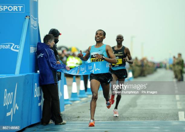Ethiopa's Kenenisa Bekele wins the 2013 Great North Run between Newcastle and South Shields ahead of Great Britain's Mo Farah