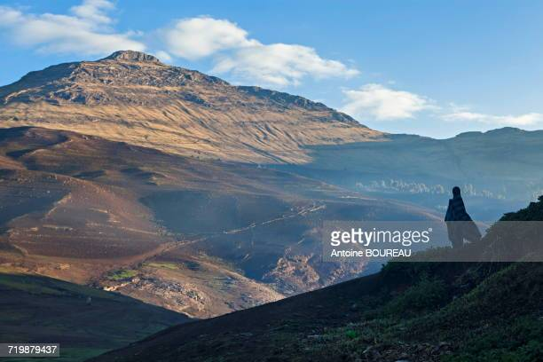 Ethiopia, Man looking at the Simien mountains at dawn