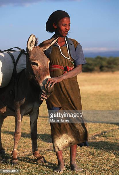 Ethiopia people Woman of the Oromo tribe with her donkey. Lake Abijata, Ethiopia