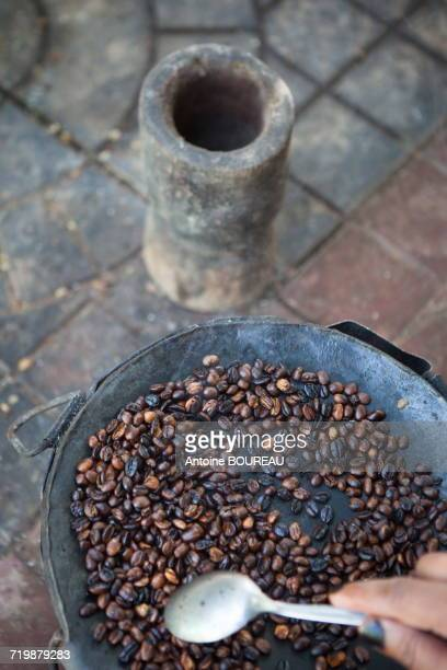 Ethiopia, Roasting of the coffee seeds on a metal plate on wood fire,  Awassa