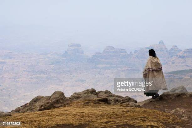 Ethiopia, Woman seen from behind looking at the Simien mountains