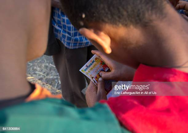 Ethiopian child playing a scratchoff lottery on January 18 2017 in Lalibela Ethiopia