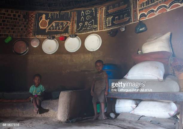 Ethiopian children inside a traditional house with decorated and painted walls Kembata Alaba Kuito Ethiopia on March 9 2016 in Alaba Kuito Ethiopia