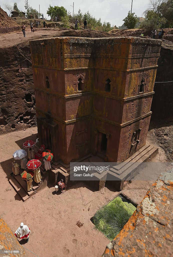 Ethiopian clergymen stand under umbrellas outside Bete Giyorgis, also called St. George's Church, at the Lalibela holy sites on March 19, 2013 in Lalibela, Ethiopia. Lalibela is among Ethiopia's holiest of cities and is distinguished by its 11 churches hewn into solid rock that date back to the 12th century. Construction of the churches was begun by Ethiopian Emperor Gebre Mesqel Lalibela, who sought to create an alternative pilgrimage site after the Muslim occupation of Jerusalem. Lalibela was the capital of Ethiopia until the 13th century.