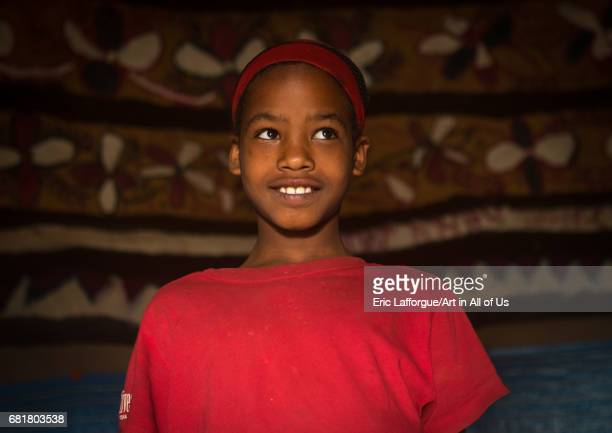 Ethiopian girl inside her traditional painted and decorated house Kembata Alaba Kuito Ethiopia on March 8 2016 in Alaba Kuito Ethiopia