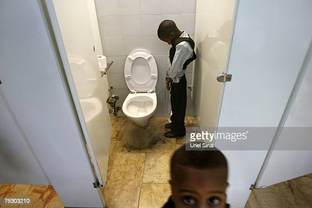 Ethiopian Jewish boys use the toilets as their parents complete the immigration process on May 3 2007 at Israel's Ben Gurion Airport near Tel Aviv...