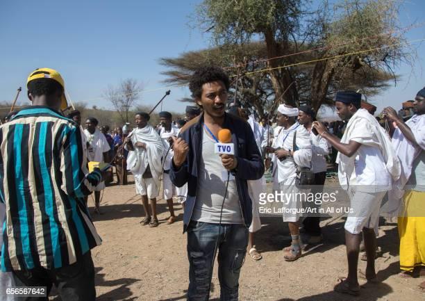 Ethiopian journalist during the Gada system ceremony in Borana tribe Oromia Yabelo Ethiopia on March 7 2017 in Yabelo Ethiopia