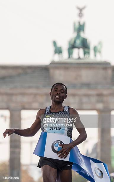 Ethiopian Kenenisa Bekele crosses the finish line to win the 43rd Berlin Marathon in Berlin on September 25 2016 / AFP / John MACDOUGALL