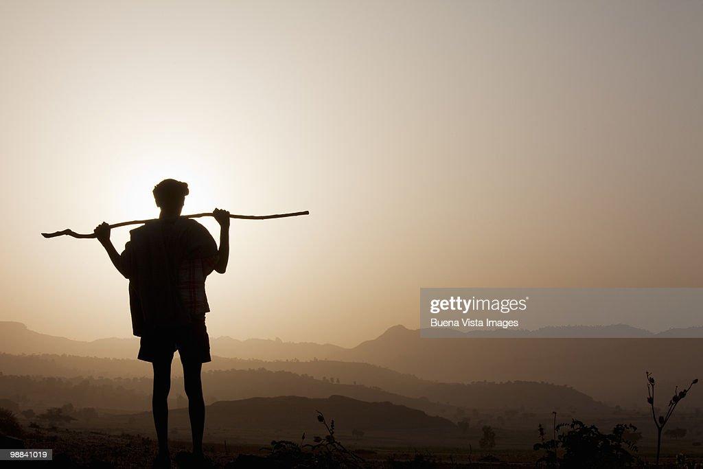 Ethiopian man watching sunrise