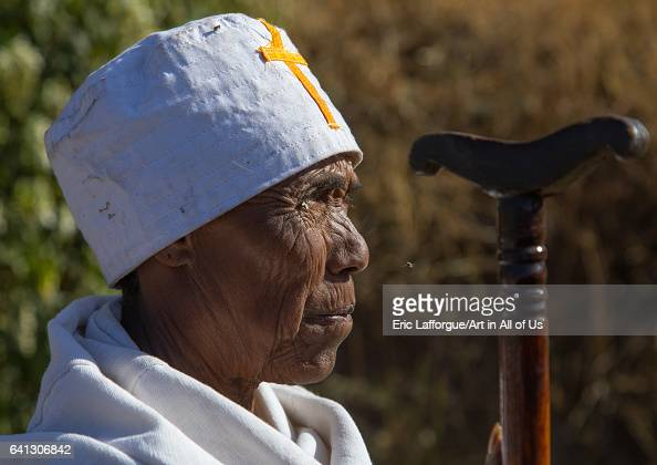 Ethiopian monk woman with her stick during Timkat epiphany festival on January 18 2017 in Lalibela Ethiopia