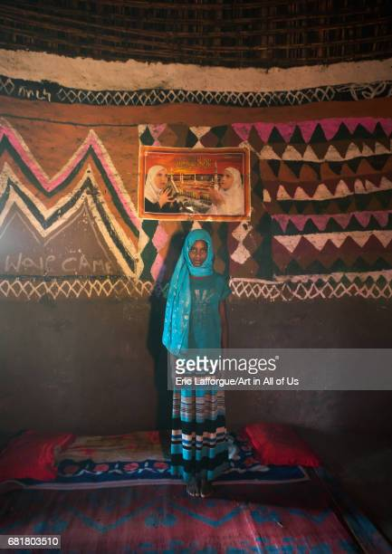Ethiopian muslim girl inside her traditional painted and decorated house Kembata Alaba Kuito Ethiopia on March 8 2016 in Alaba Kuito Ethiopia