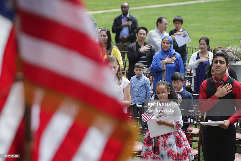 Ethiopian native Kidist Getachew (2nd R), 9; and Pakistani native Annan Zulfiqar (R), 13, swear the oath of allegiance during a childrens citizenship ceremony at President Lincoln's Cottage at the Soldiers' Home May 2, 2016 in Washington, DC. Twenty one children from 19 countries, including Syria, South Korea and El Salvador, became new United States citizens during the ceremony sponsored by the U.S. Citizenship and Immigration Services. President Abraham Lincoln and his family resided seasonally on the grounds of the Soldiers' Home to escape the heat and politics of downtown Washington, as did President James Buchanan before him and presidents Rutherford B. Hayes and Chester A. Arthur from 1885 to 1887.