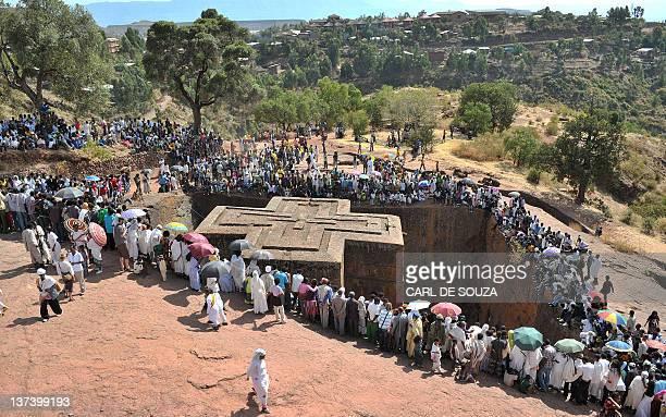 Ethiopian Orthodox Christian gather near to the rockhewn church Bete Giyorgis during the annual festival of Timkat in Lalibela Ethiopia which...