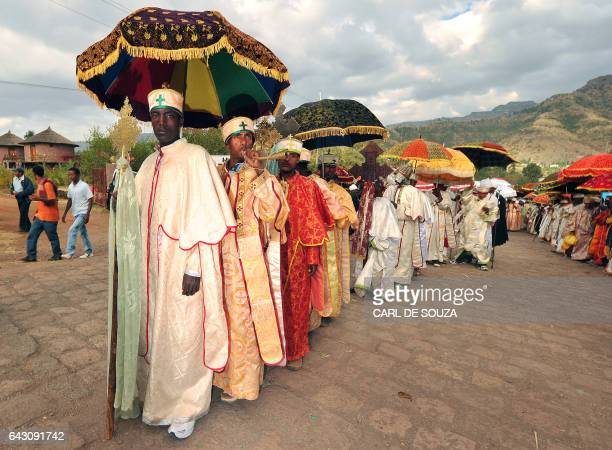 Ethiopian Orthodox Christian priests and monks line up during the annual festival of Timkat in Lalibela Ethiopia which celebrates the Baptism of...