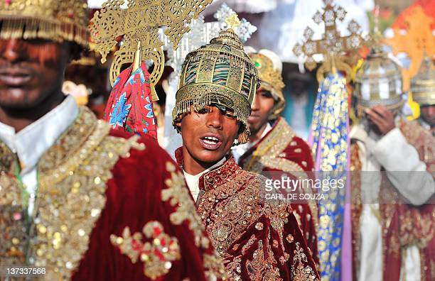 Ethiopian Orthodox Christian priests and monks take part in a procession during the annual festival of Timkat in Lalibela on January 19 2012 The...