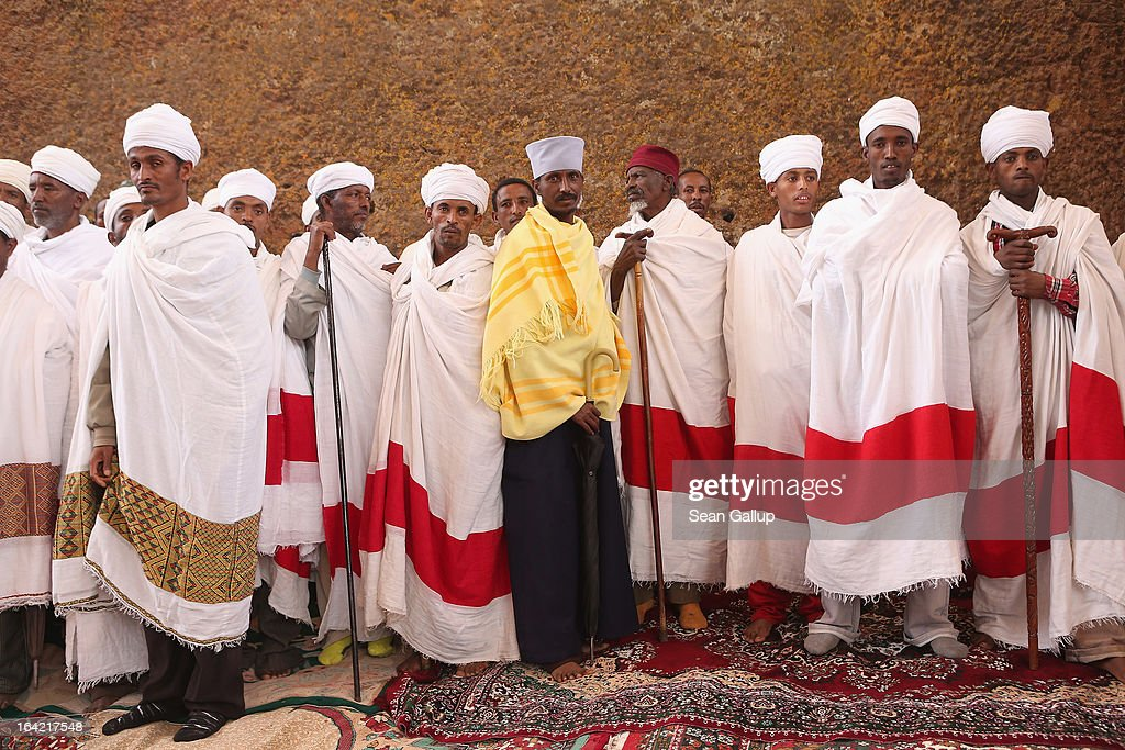 Ethiopian Orthodox clergy members attend the performance of a ritual involving song, dance and a small procession outside Bete Maryam, als called St. Mary's, Church on the occasion of the visit of German President Joachim Gauck at the Lalibela holy sites on March 19, 2013 in Lalibela, Ethiopia. Lalibela is among Ethiopia's holiest of cities and is distinguished by its 11 Christian churches hewn into solid rock that date back to the 12th century. Construction of the churches was begun by Ethiopian Emperor Gebre Mesqel Lalibela, who sought to create an alternative pilgrimage site after the Muslim occupation of Jerusalem in 1187. Lalibela was the capital of Ethiopia until the 13th century.