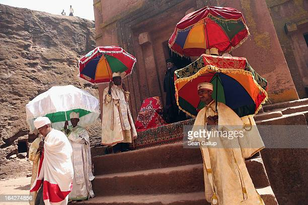 Ethiopian Orthodox clergy members stand outside Bete Giyorgis also called St George's Church at the Lalibela holy sites on March 19 2013 in Lalibela...
