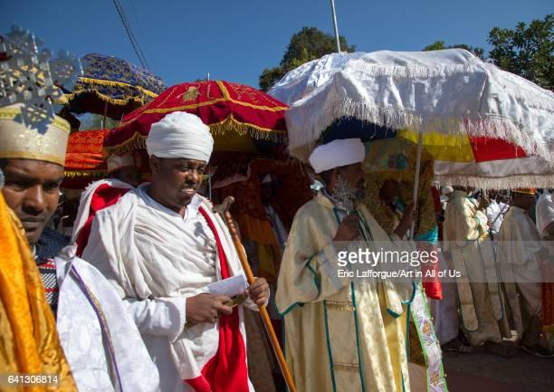 Ethiopian orthodox priests procession celebrating the colorful Timkat epiphany festival on January 18 2017 in Lalibela Ethiopia