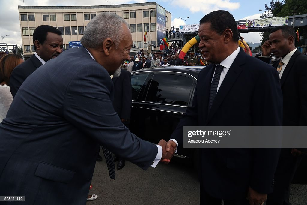 Ethiopian President Mulatu Teshome (R) shakes hands with the Ethiopian Patriots Association President Lij Daniel Jote Mesfin during a national holiday celebrating the liberation from Italian occupation at the Miazia 27 square in Addis Ababa, Ethiopia on May 5, 2016. Patriots Victory Day commemorates those who died during the occupation and honors veterans of the resistance movement.
