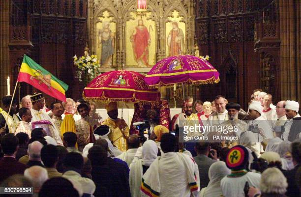 Ethiopian priest Arch Mandrite Abba Markos carries the Tabot wrapped in ceremonial clothes on his head during the handing over ceremony for the...