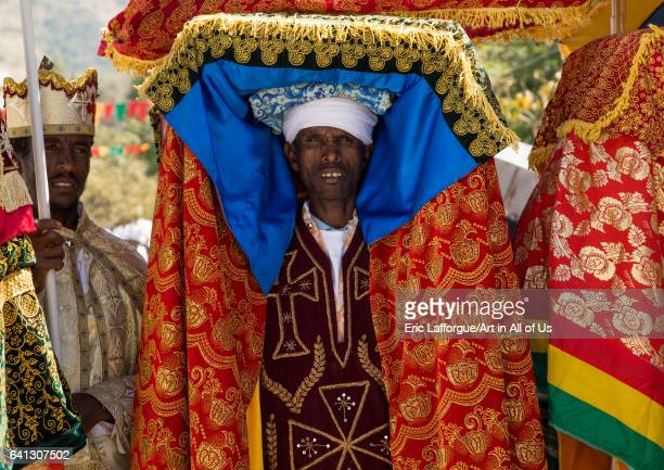 Ethiopian priest carrying a covered tabot on his head during Timkat epiphany festival on January 19 2017 in Lalibela Ethiopia