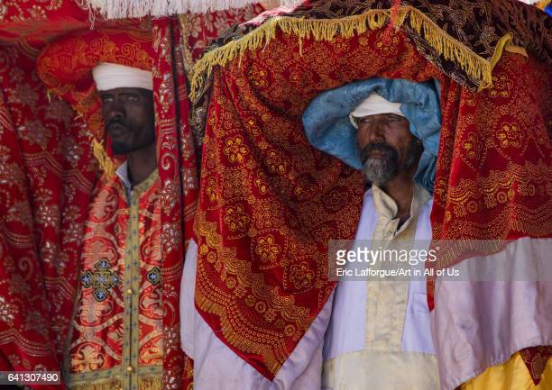 Ethiopian priests carrying some covered tabots on their heads during Timkat epiphany festival on January 19 2017 in Lalibela Ethiopia