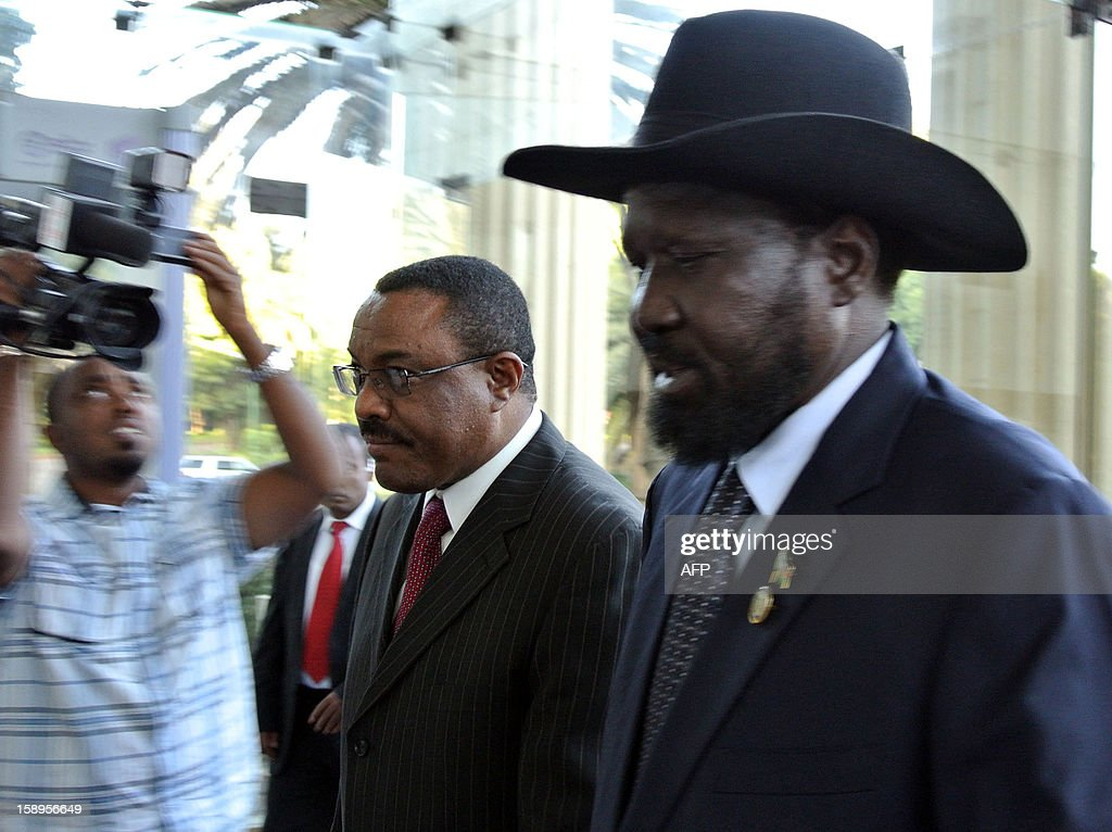 Ethiopian Prime Minister Hailemariam Desalegn (2nd L) arrives with the President of South Sudan, Salva Kiir (R) in Addis Ababa on January 4, 2013. Kiir is in the Ethiopian capital on Hailemariam's invitation to meet with his Sudanese counterpart, Omar al Bashir, to push for progress on stalled oil, border and security talks. The two former civil war foes signed a raft of agreements in September, but none have yet been implemented, with the South accusing Khartoum of fresh attacks this week. Negotiations between the two rivals have been ongoing since Juba split from the North in July 2012, and though a series of deals have been forged, none have been successfully put in place. AFP PHOTO/JENNY VAUGHAN.